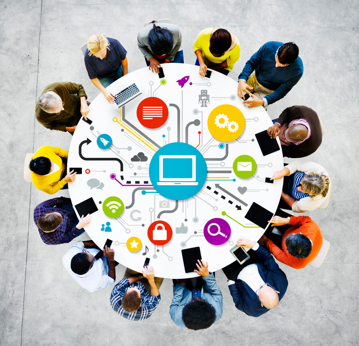 People at a round table with networking graphic.
